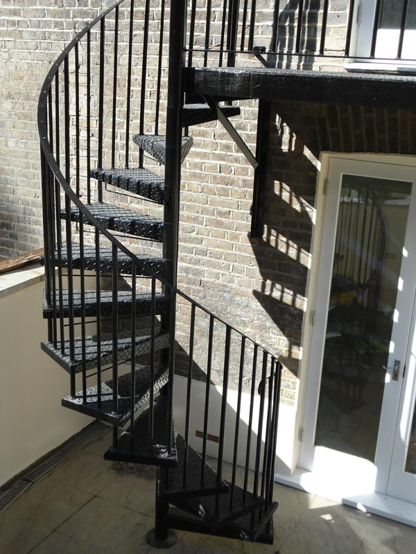 Steel spiral staircase balcony landing fabrication for Pre made spiral staircase