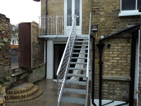 Outdoor steel staircase balcony london cecilia road for Steel balcony